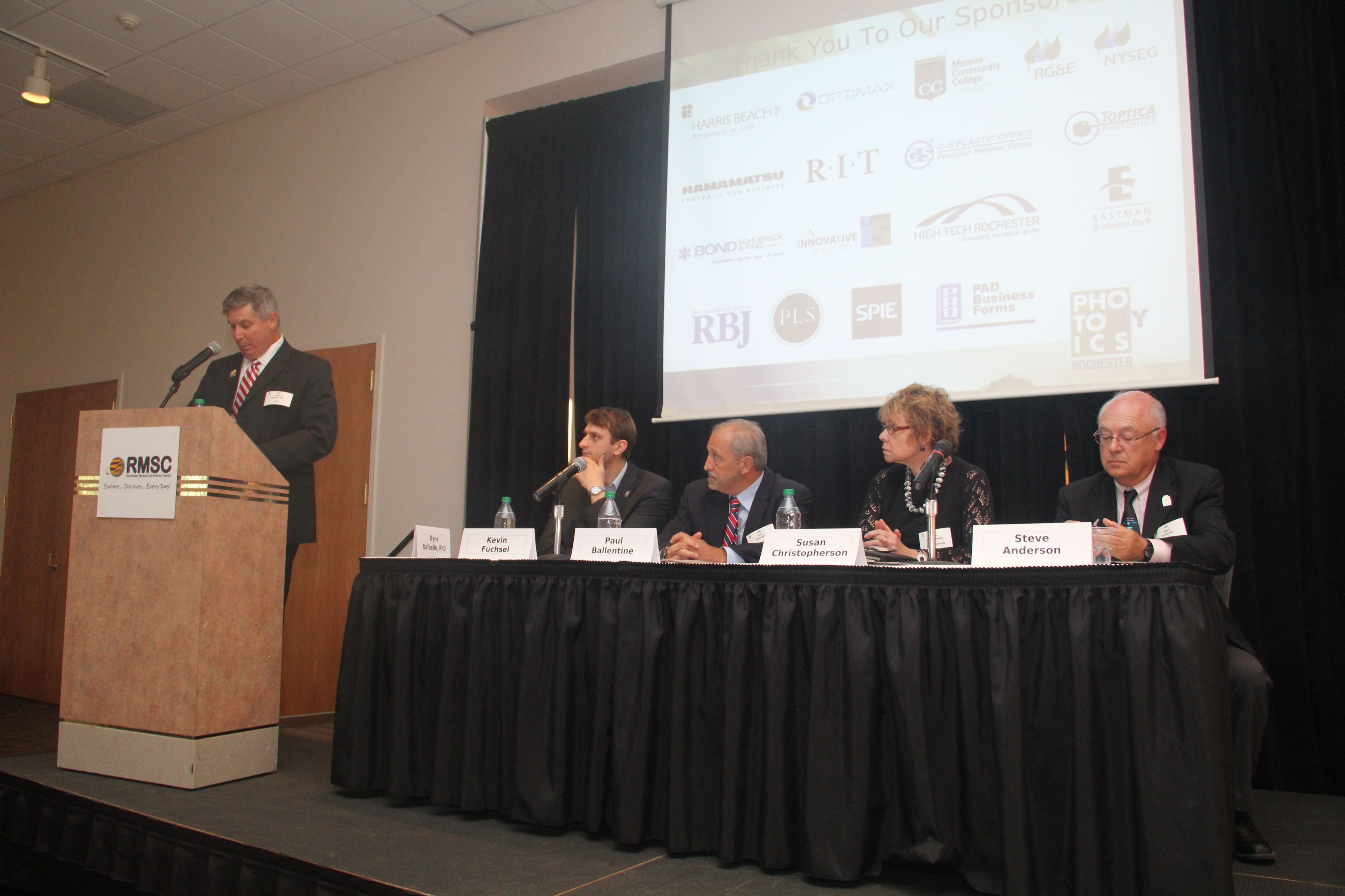 Dr. Ryne Raffaelle of RIT moderates a discussion panel which includes, L to R,