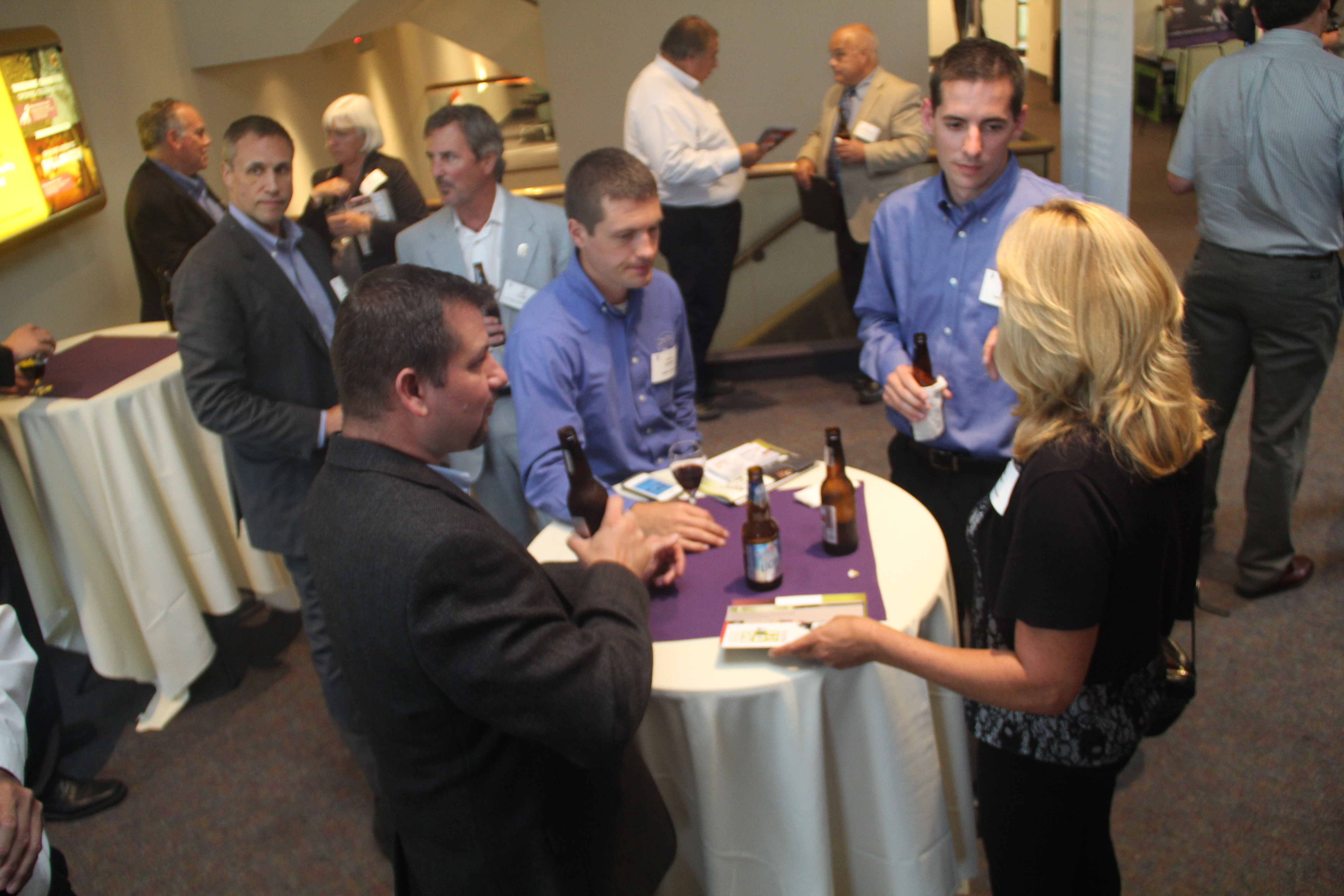 Attendees network after the meeting at the Rochester Museum and Science Center