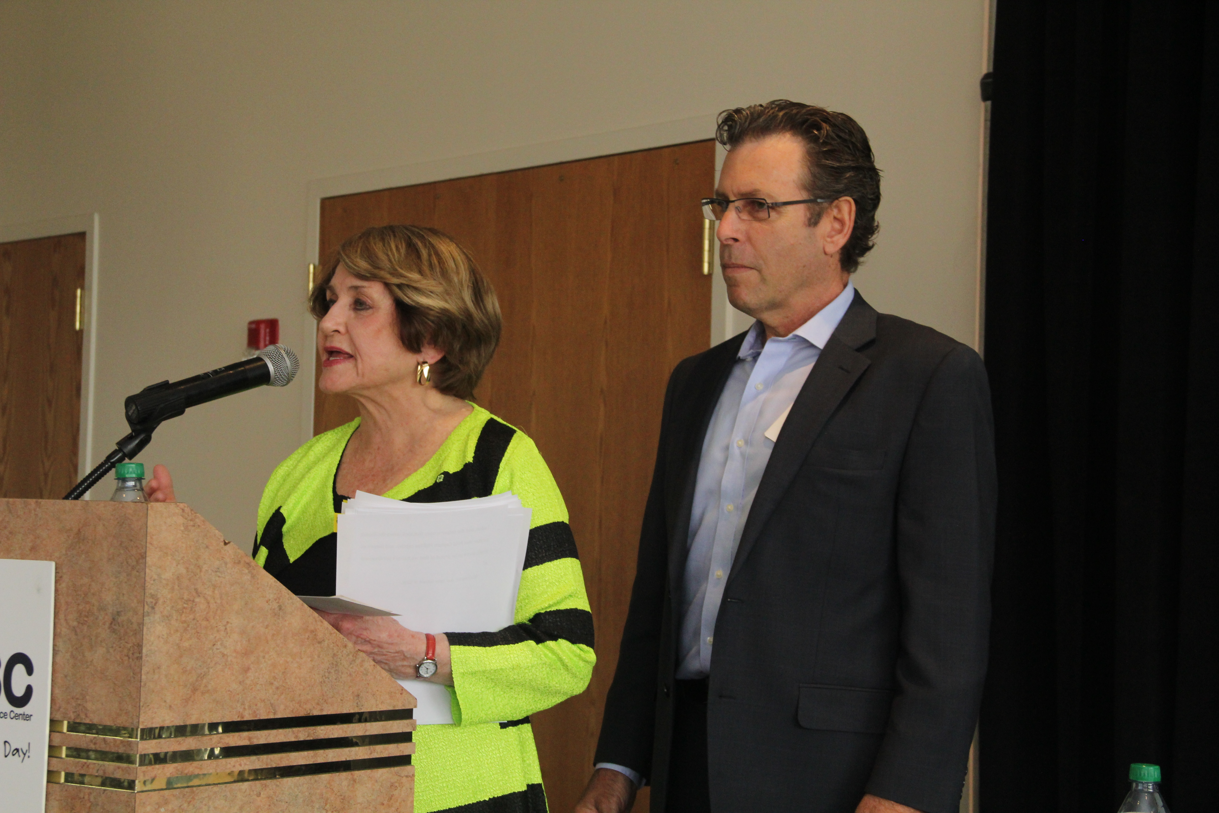 Congresswoman Louise Slaughter delivers opening remarks at RRPC's Annual Meeting Sept. 4 as RRPC Executive Director Tom Battley looks on.