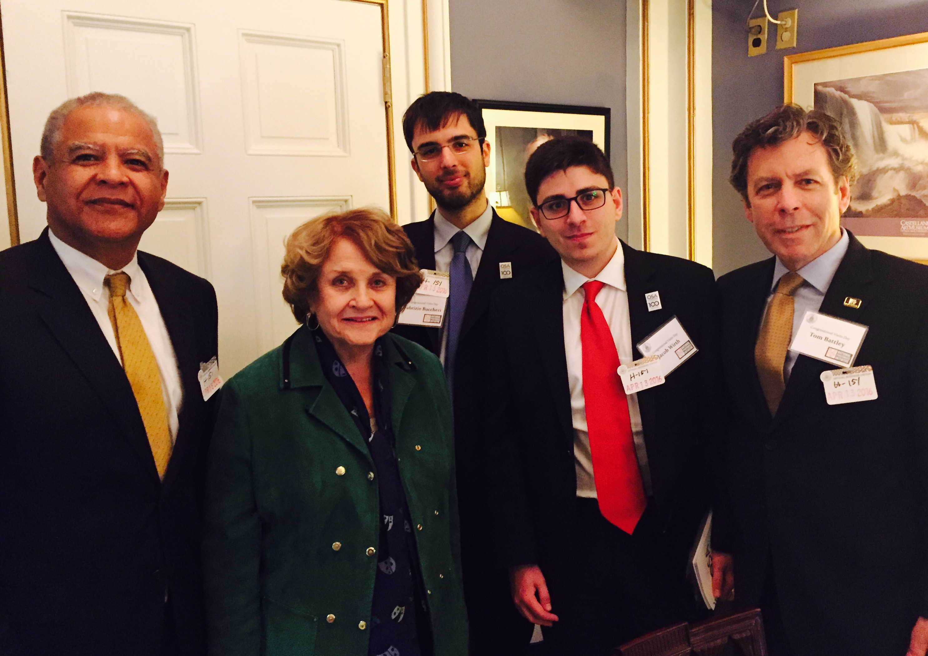 In Rochester Congresswoman Louise Slaughter's office. Left to right: AIM Photonics Executive, Ed White; Congresswoman Louise Slaughter (NY25); UR PhD candidate, Fabrizio Buccheri; RIT PhD candidate, Jacob Wirth; New York Photonics Executive Director, Tom Battley